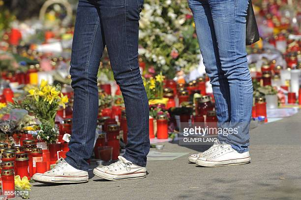 Mourners lay flowers in front of the Albertville secondary school during a central memorial service for the 15 victims of a rampage shooting on March...