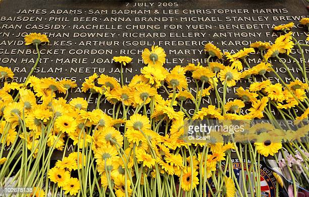 Mourners lay yellow flowers at the memorial to the victims of the July 7 2005 London bombings in Hyde Park on July 7 2010 in London England Today...