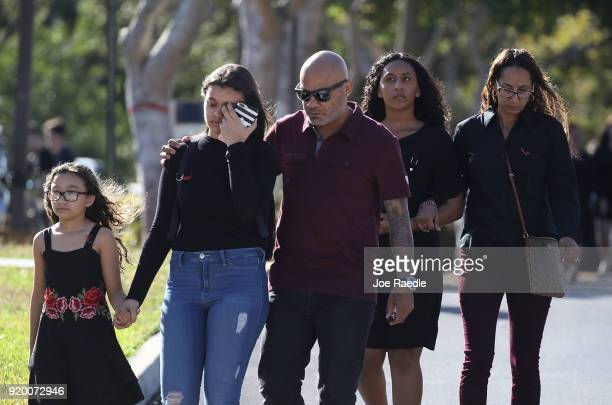 Mourners leave after attending the funeral for Scott Beigel geography teacher from Marjory Stoneman Douglas High School after a funeral service at...