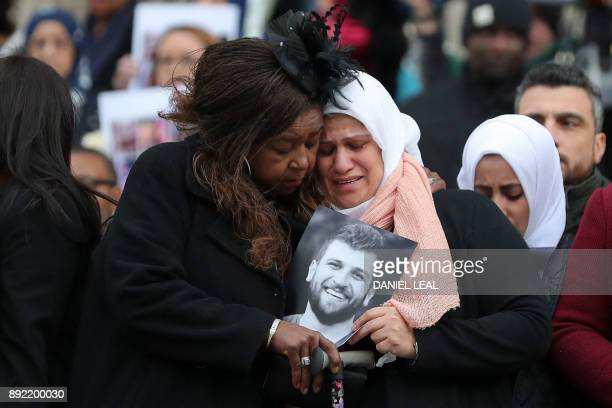 TOPSHOT Mourners leave after attending the Grenfell Tower National Memorial Service at St Paul's Cathedral in London on December 14 to mark the six...