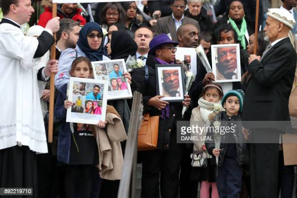Mourners leave after attending the Grenfell Tower National Memorial Service at St Paul's Cathedral in London on December 14 to mark the six month...