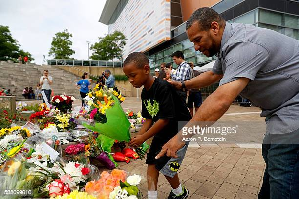 Mourners leave flowers at a memorial following the death of boxing legend Muhammad Ali outside the Muhammad Ali Center June 4 2016 in Louisville...
