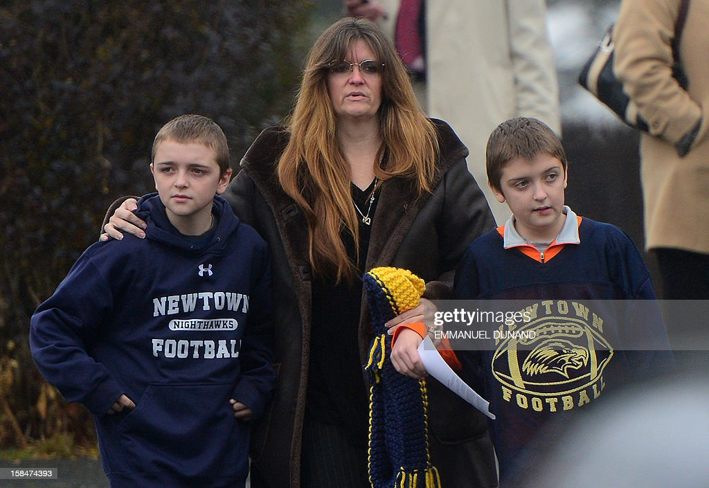 Mourners leave from Honan funeral home after attending the funeral for Jack Pinto, 6, one of the victims of the Sandy Hook elementary school shooting, on December 17, 2012, in Newtown, Connecticut. Funerals began in the little Connecticut town of Newtown after the school massacre that took the lives of 20 small children and six staff, triggering new momentum for a change to America's gun culture. AFP PHOTO/Emmanuel DUNAND
