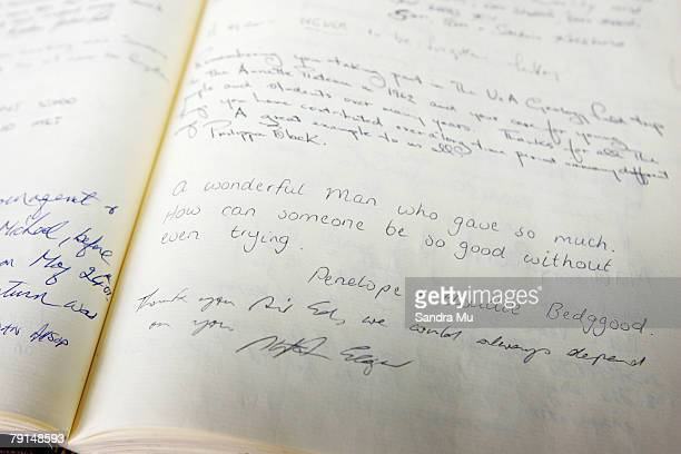Mourners leave messages inside the book of remembrance prior to the State Funeral for Sir Edmund Hillary at St Marys Church on January 22 2008 in...