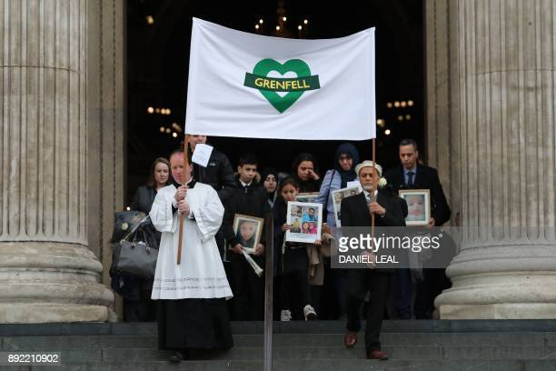 Mourners leave St Paul's cathedral after attending a Grenfell Tower National Memorial service on December 14 2017 in central London The fire on June...