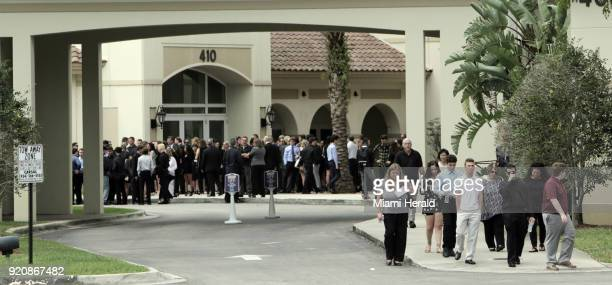 Mourners leave the Church by the Glades on Monday, Feb 19, 2018 in Coral Springs, Fla. After funeral services for Luke Hoyer, one of the 17 victims...