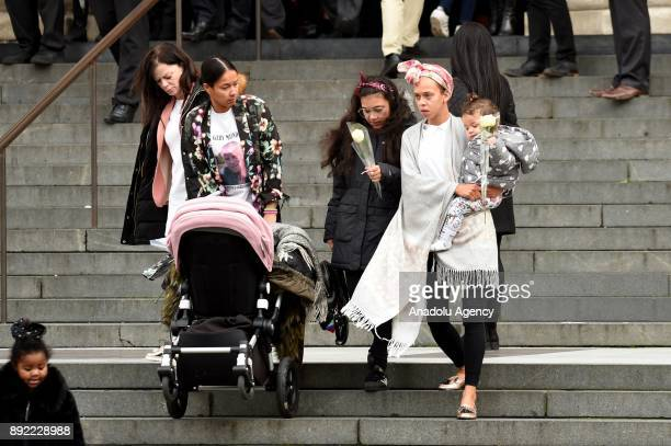 Mourners leave the Grenfell Tower National Memorial Service held at St Paul's Cathedral on December 14 2017 in London England The Royal Family and...