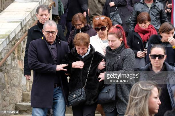 Mourners leave the service of remembrance at the Saint Etienne Church in Trebes in southwest France on March 25 two days after a man carried out an...