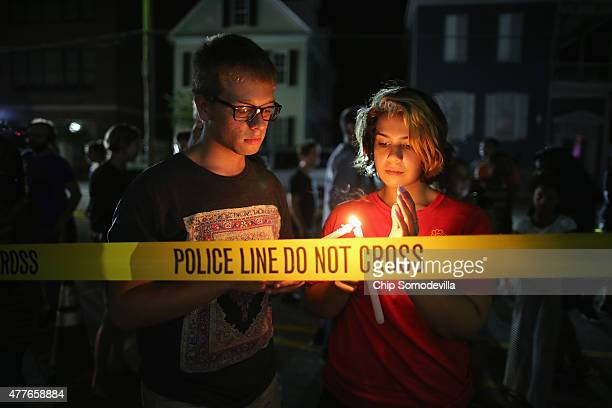Mourners light candles for the nine victims of last night's shooting at the historic Emanuel African Methodist Episcopal Church June 18 2015 in...