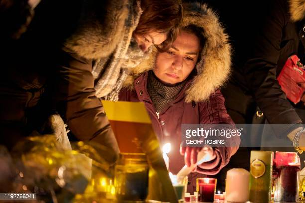 Mourners light candles for the victims of Ukrainian Airlines flight 752 which crashed in Iran during a vigil at Mel Lastman Square in Toronto Ontario...