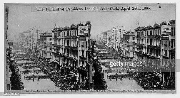 Mourners line the street as President Lincoln's funeral procession passes through New York City on April 25 1865 Lincoln's body was taken by train to...