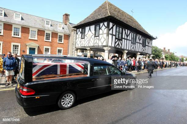 Mourners line the streets as the coffin of Trooper Joshua Hammond 18 is slowly driven through the town of Wooton Bassett in Wiltshire after being...