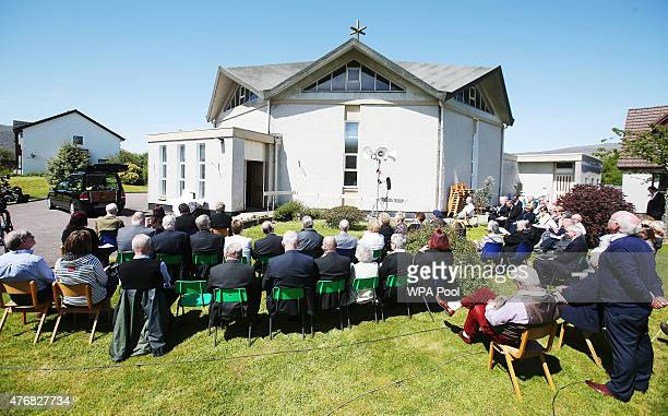 Mourners listen to the funeral service of former Liberal Democrat leader Charles Kennedy outside St John's Roman Catholic Church on June 12 2015 in...