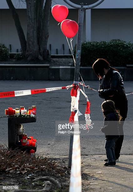 Mourners look at candles outside the local high school on March 14 2009 in Winnenden Germany 17 year old Tim Kretschmer opened fire on March 11 on...