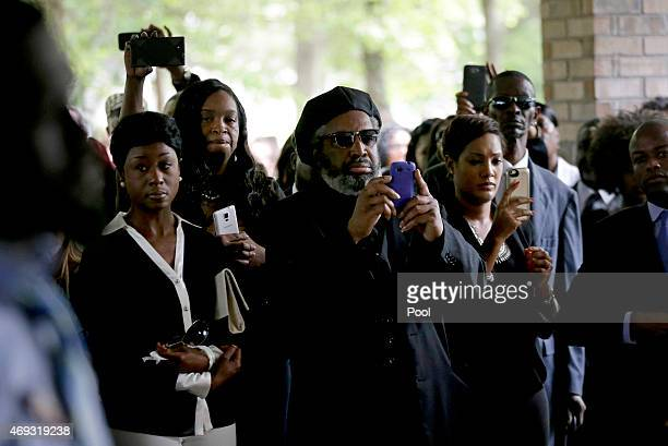 Mourners look on as the casket of Walter Scott is wheeled in for his funeral at WORD Ministries Christian Center April 11 2015 in Summerville South...