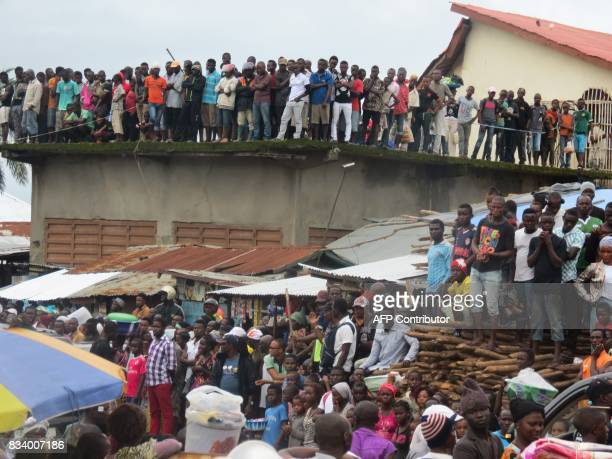 TOPSHOT Mourners look on as victims of a mudslide are buried at the Paloko Cemetery in Waterloo on August 17 2017 Sierra Leone buried at least 300...