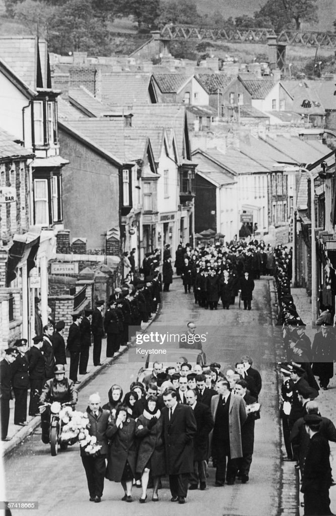 Mourners make their way through the Welsh town of Aberfan, for the mass burial of eighty-two victims of the mining disaster a week earlier, 27th October 1966. A hundred and forty-four people died when a slag heap slid down nearby Merthyr Mountain and engulfed the local school.