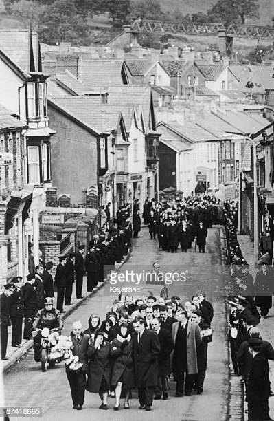 Mourners make their way through the Welsh town of Aberfan for the mass burial of eightytwo victims of the mining disaster a week earlier 27th October...