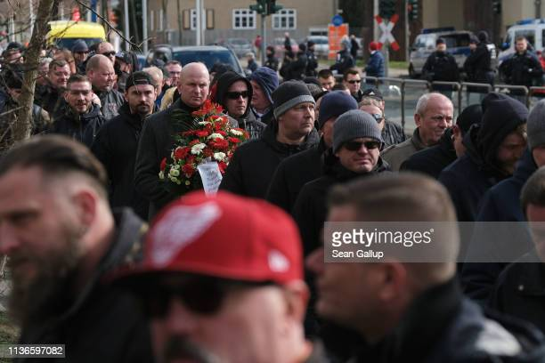 Mourners many of them from the Chemnitz football hooligan scene walk into Michaelis cemetery to pay their last respects to local hooligan scene...