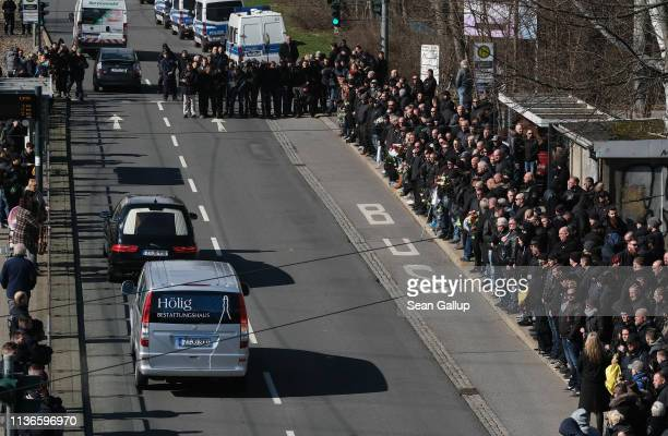 Mourners many of them from the Chemnitz football hooligan scene watch the hearse carrying the coffin of local hooligan scene leader Thomas Heller...