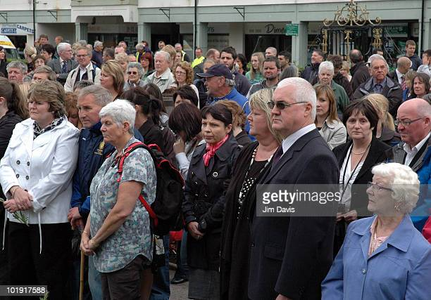 Mourners observe a minutes silence for the 12 victims of last week's gun rampage by Derrick Bird June 09 2010 in Whitehaven England There are nine...