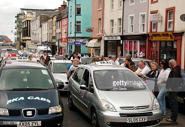 Mourners observe a minutes silence for the 12 victims of last week's gun rampage by Derrick Bird beside the taxi rank on June 09 2010 in Whitehaven...