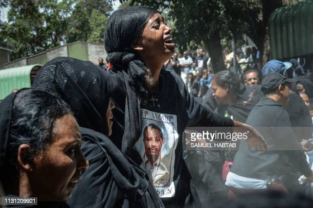 TOPSHOT Mourners of victims of the crashed accident of Ethiopian Airlines react during the mass funeral at Holy Trinity Cathedral in Addis Ababa...