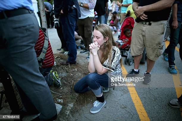 Mourners outside the historic Emanuel African Methodist Episcopal Church June 18, 2015 in Charleston, South Carolina. Dylann Storm Roof of Lexington,...