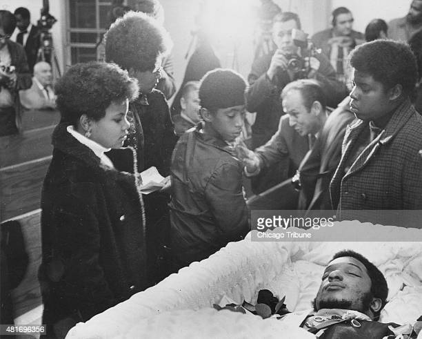 Mourners pass by the coffin of Black Panthers leader Fred Hampton at his memorial service on Dec 9 at the First Baptist Church of Melrose Park in...