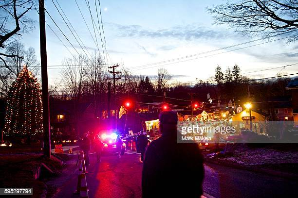 Mourners pass through a central intersection in Sandy Hook CT the day after a mass shooting of 20 children and 7 adults at Sandy Hook Elementary...
