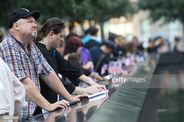Mourners pause at the South Pool of the 9/11 Memorial during ceremonies for the twelfth anniversary of the terrorist attacks on lower Manhattan at...