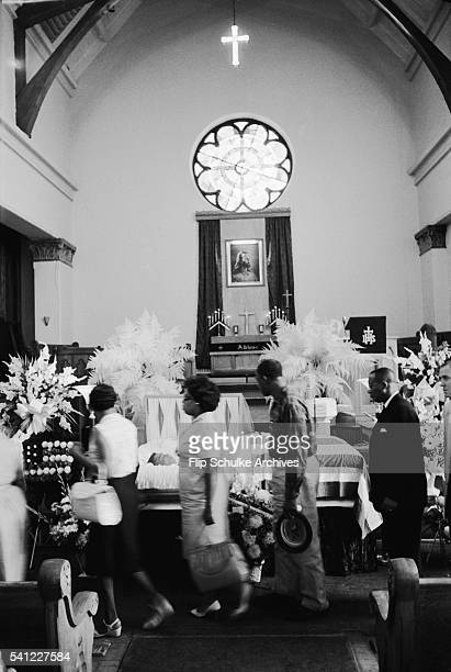 Mourners pay their last respects to slain civil rights leader Medgar Evers at a church