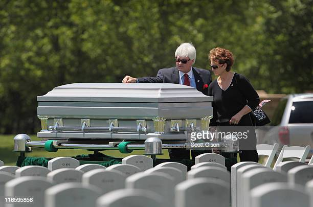 Mourners pay their last respects to US Army PFC Michael Olivieri of Homer Glen Illinois following a service at Abraham Lincoln National Cemetery on...