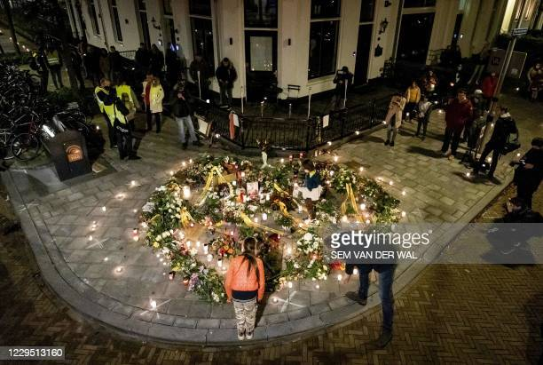 Mourners pay their respect during the commemoration for Jan Kruitwagen, a victim of senseless violence, in Arnhem, the Netherlands, November 7, 2020....