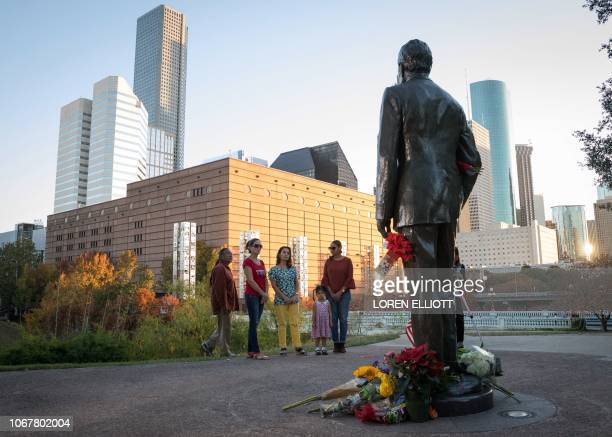 Mourners pay their respects at a makeshift memorial in tribute to former US President George H W Bush at a monument in his honor in Houston Texas on...
