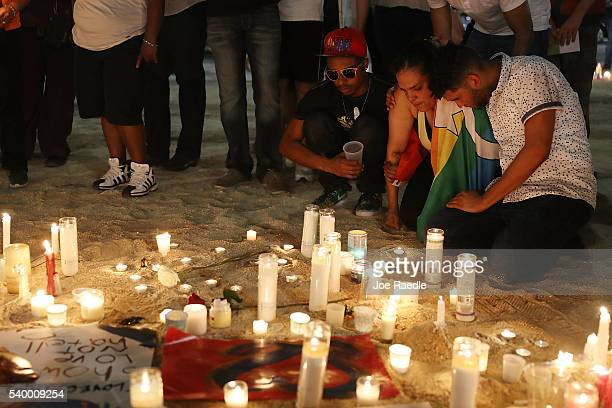 Mourners pay their respects at a memorial in front the Dr Phillips Center for the Performing Arts for the victims of the Pulse gay nightclub shooting...