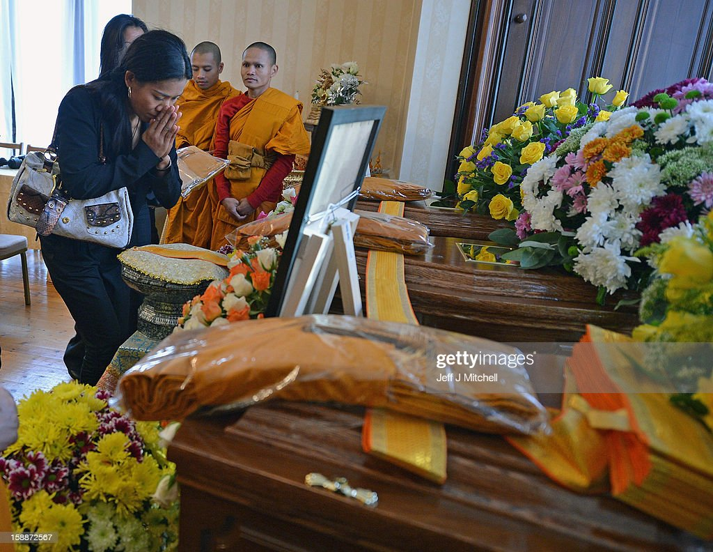 Mourners pay their respects at a service of remembrance for three Thai Buddhist Monks who died in a car crash on Christmas Eve, at Oakvale Funeral Home on January 2, 2013 in Edinburgh, Scotland. Abbot Phramaha Pranom Thongphaiboon, 43, head of the Thai Buddhist community in Aberdeen, was killed in a car crash on Christmas Eve along with his colleagues Phramaha Kriangkrai Khamsamrong, 35, and Phramaha Chai Boonma, 36. The three men were travelling to the Dhammapadipa Temple in Edinburgh when they were involved in the head-on collision on the A68 near Pathhead, Midlothian.