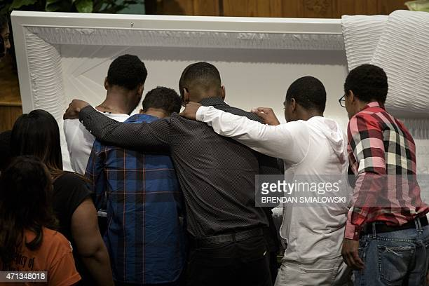 Mourners pay their respects at the casket of Freddie Gray before his funeral at New Shiloh Baptist Church April 27 2015 in Baltimore Maryland Family...