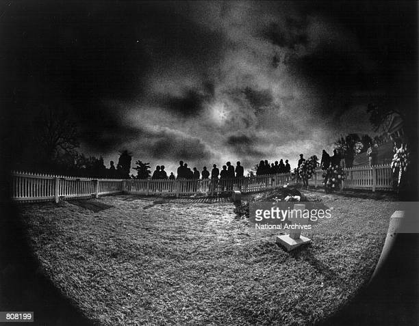 Mourners pay their respects at the gravesite of President John F Kennedy in Arlington Cemetary