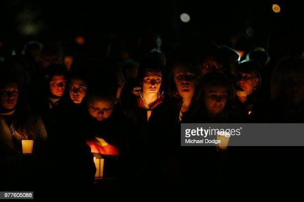 Mourners pay their respects during a vigil held in memory of murdered Melbourne comedian 22yearold Eurydice Dixon at Princess Park on June 18 2018 in...