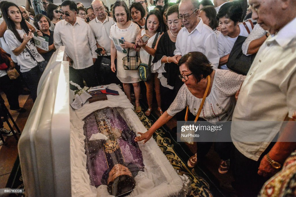 Catholics expresses shock over killing of activist priest in the Philippines : News Photo