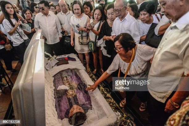 Mourners pay their respects during the funeral of activist priest Fr Marcelito quotTitoquot Paez in San Jose Nueva Ecija north of Manila Philippines...