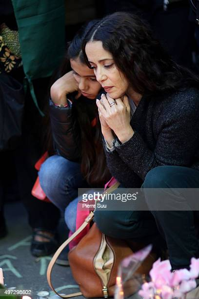Mourners pay their respects near the 'Bataclan' on November 15 2015 in Paris France As France observes three days of national mourning members of the...