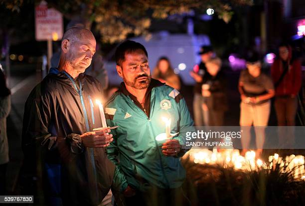 Mourners pay tribute to the victims of the Orlando shooting during a memorial service in San Diego California on June 12 2016 Fifty people died when...