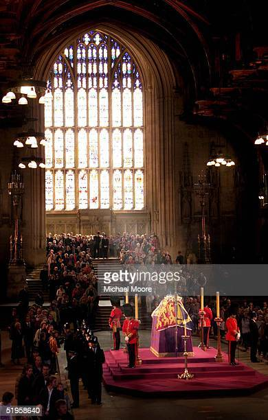 POOL Mourners paying their last respects file past the coffin of Queen Elizabeth the Queen Mother which lies in state at Westminster Hall in central...