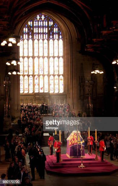 Mourners paying their last respects, file past the coffin of Queen Elizabeth, the Queen Mother which lies in state at Westminster Hall in central...