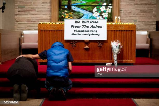 Mourners pray during a vigil for Camp Fire victims at the First Christian Church of Chico on November 18 2018 in Chico California The blaze has...