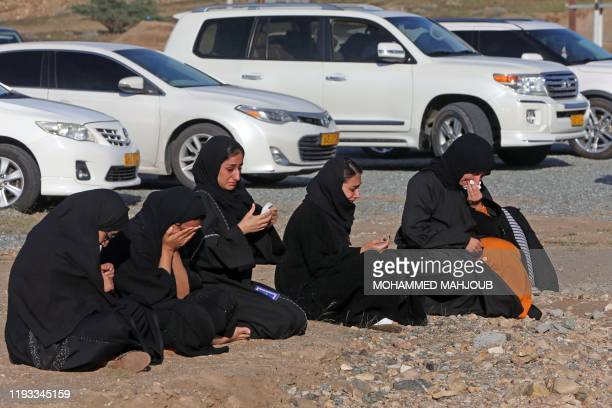 Mourners pray for late Omani leader Sultan Qaboos outside the Royal Family Cemetery outside Oman's capital Muscat on January 12 2020 Oman's Sultan...