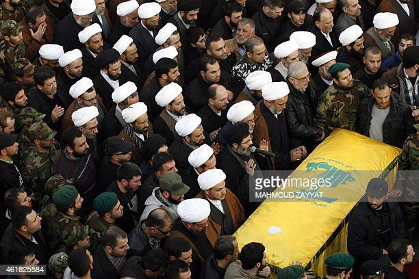 Mourners pray over the casket of Hezbollah military leader Mohammed Issa a senior commander responsible for Hezbollah operations in Syria and Iraq...