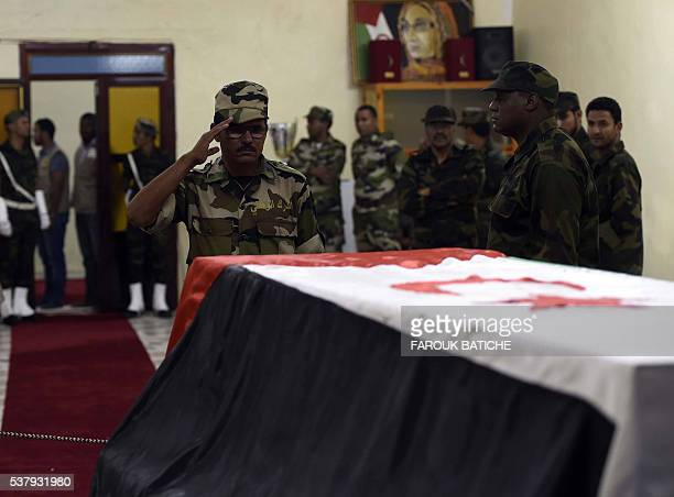 Mourners pray over the coffin of Mohamed Abdelaziz the leader of the Western Sahara's Polisario Front during his funeral in the Algerian city of...